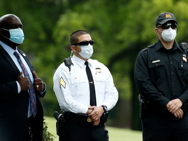 Outdoor press conferences and masked Secret Service agents: Inside the White House handling the coronavirus crisis.