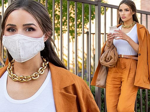 Olivia Culpo embodies glamour in an eye catching orange suit as she runs errands in Los Angeles