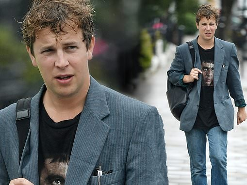 Tom Odell cuts a casual figure in a Scarface T-shirt as he heads out for a lockdown stroll in London