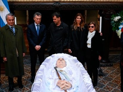 Former Argentine President De la Rua buried in private ceremony