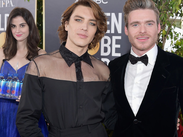 Golden Globes 2019 Red Carpet: Woman Holding Fiji Water Steals The Show