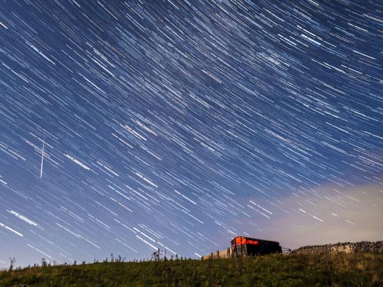 Sky lights up at night as Perseid meteors visit Earth