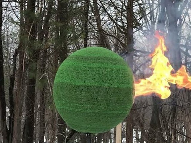 Man set a sphere made of matches on fire, and it is, in fact, lit
