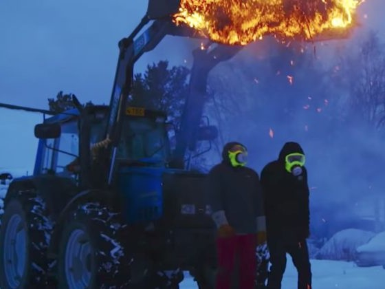They Were About To Dump Out A Flaming Pile Of Hay So These Guys...Stood Under It?