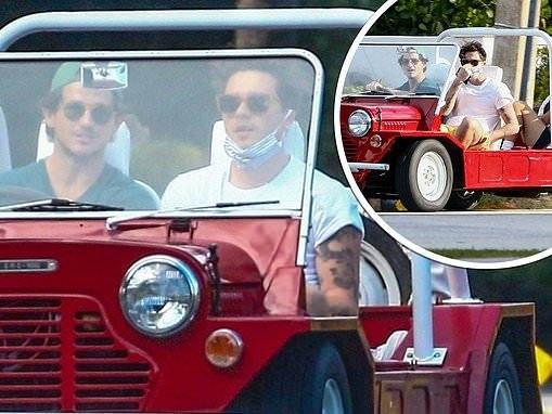 Brooklyn Beckham enjoys a spin in his friend's redMini Moke in Miami