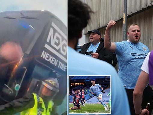 Manchester City fans gather outside Etihad and swarm around team bus