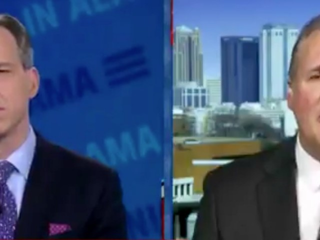 A Roy Moore campaign spokesman appeared to be speechless when a CNN host said elected officials don't have to be sworn in on the Christian Bible