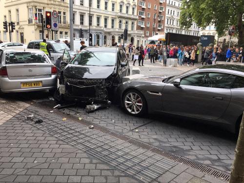 Man held after crash near London museum, 11 injured