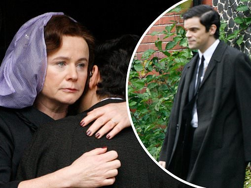 Emily Watson looks solemn as she dresses all in black and dons purple hairnet to film Midas Man