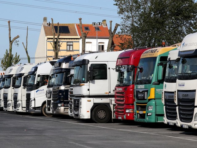 Twelve migrants found alive in refrigerated truck in Belgium a week after 39 bodies found in similar lorry in Britain