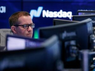 Health care companies lead US stocks lower in midday trading
