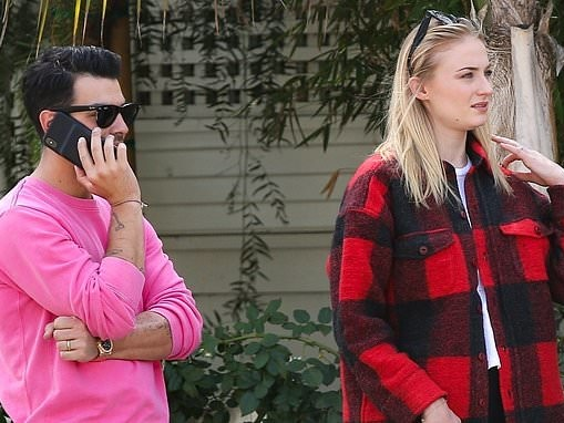 Sophie Turner keeps it casual in red tartan coat as Joe Jonas chats on phone in Beverly Hills