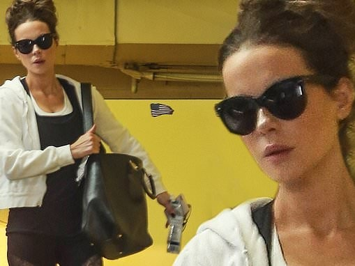 Kate Beckinsale rocks her signature gym style in leggings and knee-high boots while out in LA