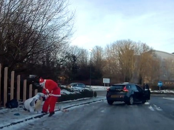 Santa Claus skids car to a halt to save woman who slipped on ice