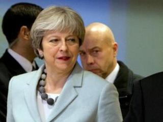 The Latest: May: Brexit deal ensures no hard Irish border