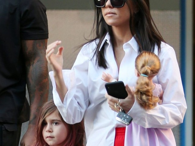 Kourtney Kardashian leaves art class as daughter Penelope reveals new purple hair