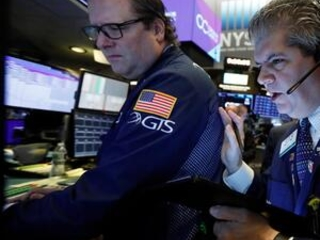 Stocks wobble as investors listen for trade deal clues