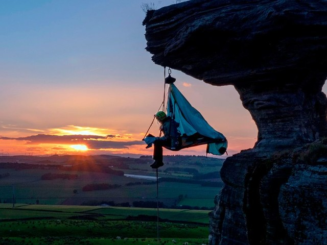 Extreme camper sleeps in tents dangling from cliffs 330ft up in the air