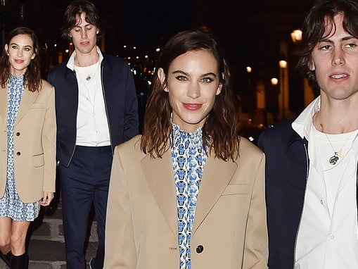 Alexa Chung, 36, looks effortlessly chic in a camel blazer in Paris