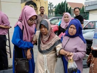 Families agree to bury all five fire victims in common grave