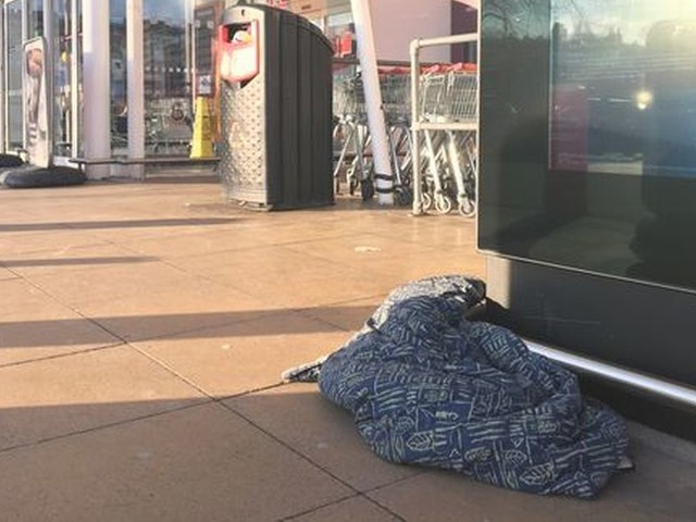 Beggars 'tormenting' shoppers outside supermarket as police urge you NOT to give them money