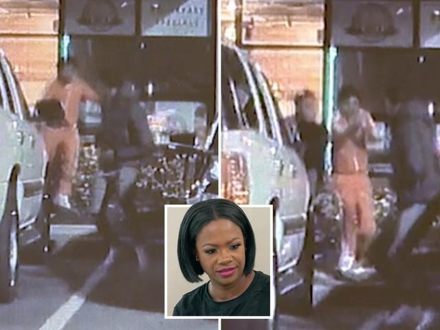 Moment gunman opened fire at RHOA star Kandi Burruss' restaurant caught on camera