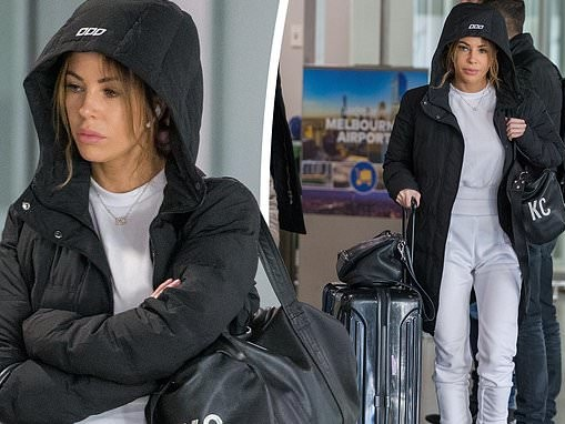 KC Osborne looks miserable as she lands back in Melbourne after doing a photo shoot in Sydney