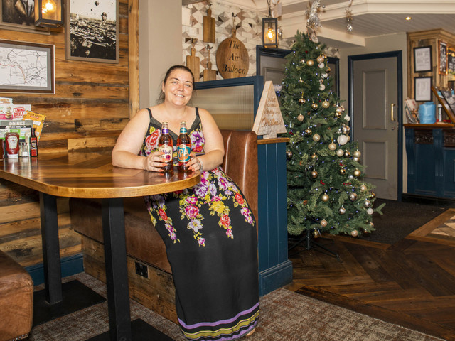 Barmy pub puts Christmas tree up five MONTHS early on hottest day of the year