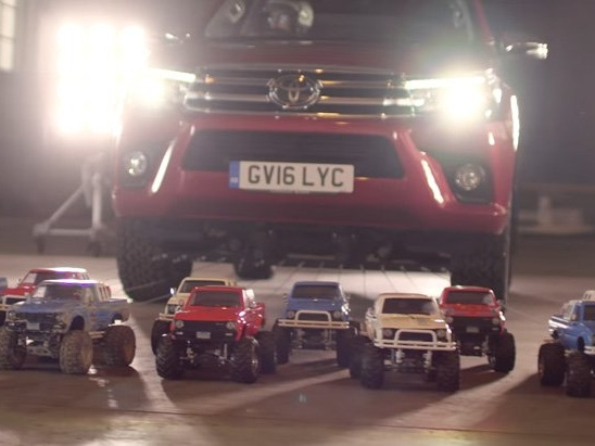 Watch a Bunch of Cute Little Toyota Trucks Pull a Big Toyota Truck