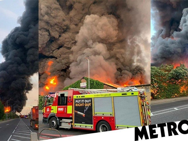 More than 100 firefighters at warehouse blaze as huge plumes of black smoke fill sky