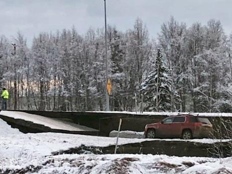 Powerful quakes buckle Alaska roads, briefly trigger tsunami warning