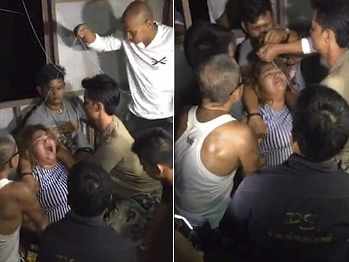 'Possessed' woman writhes in pain during exorcism