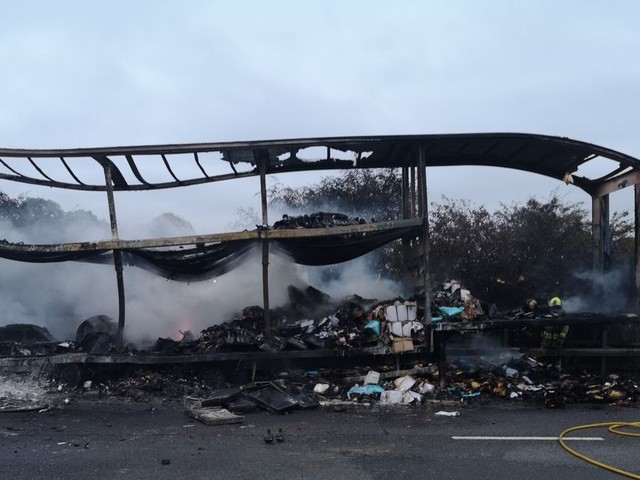 M1 shut for several hours after lorry trailer fire melts road