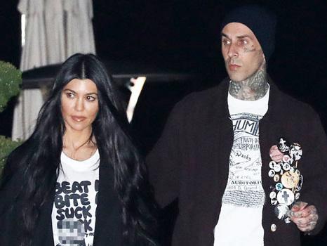 Why Kourtney Kardashian & Travis Barker Are Flaunting Their Romance In A Very 'Public Way'
