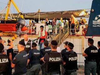 Migrant aid ship captain arrested; Italy police boat rammed
