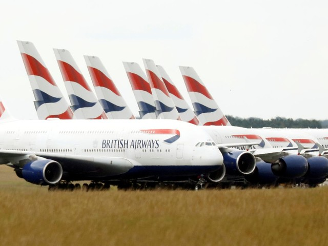 BA owner IAG downgrades outlook as virus hits demand