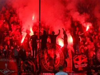 Flare lands near referee in Champions League game