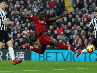 Liverpool surge past Newcastle, six points clear at the top