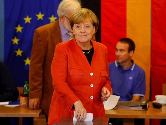 Germany warned against election apathy as Merkel expected to win fourth term