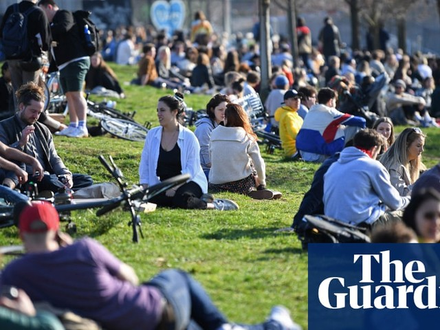 Police urge Britons to follow lockdown rules as warm weather pulls crowds