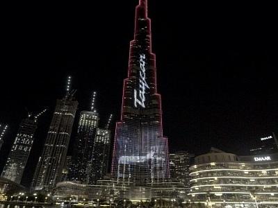 Porsche Turns World's Tallest Building into Giant Taycan Billboard