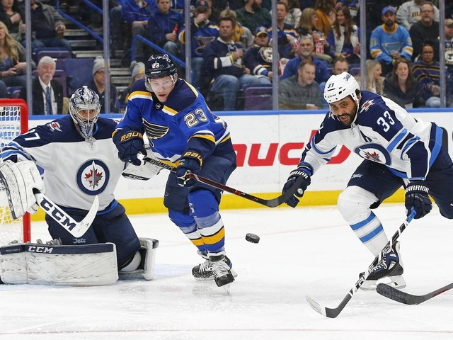 Connor Hellebuyck makes 34 saves as Jets beat Blues