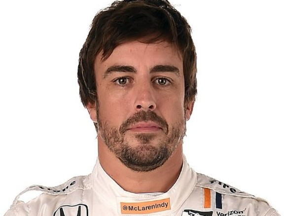 Fernando Alonso Donates Signed Race Suit To Charity Auction