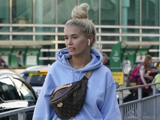 Love Island's Molly-Mae Hague dons blue tracksuit as she touches down in Manchester