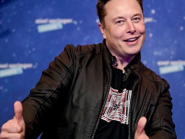 Elon Musk says Tesla will let other cars use its network of 25,000-plus Superchargers by the end of this year