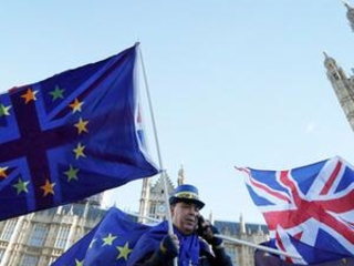 The Latest: S&P says Brexit deal doesn't solve key issues