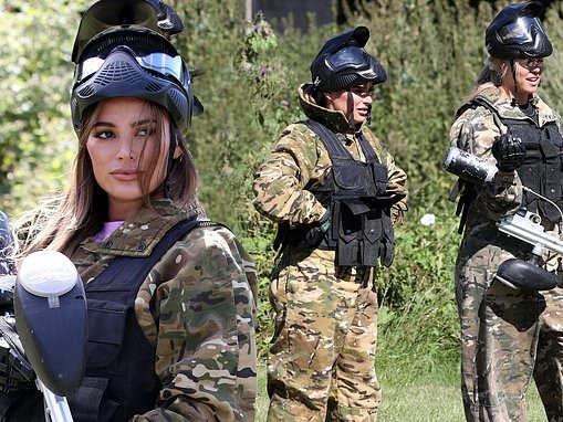 Courtney Green and Chloe Meadows don camo outfits and protective vests as they go paintballing