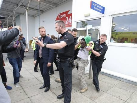 Sacked security worker arrested after protest in Tesco roof space
