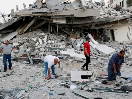 Airstrikes continue as violence in Gaza enters second week