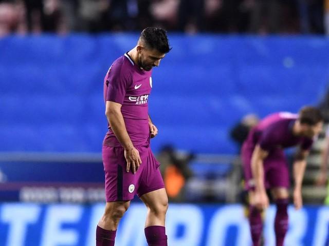Man City endure a miserable night as Wigan end Quadruple dreams